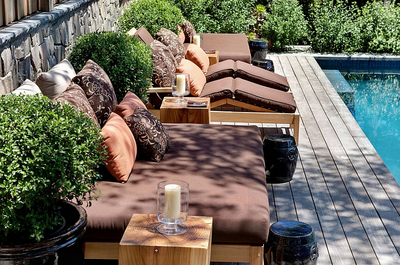 Combine the outdoor bed with some trendy recliners for a family hangout next to the pool