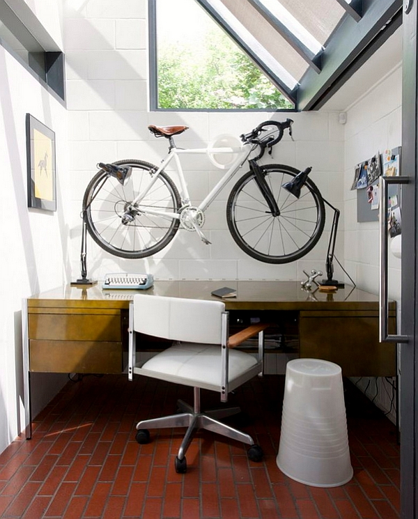 View In Gallery Compact Home Office With A Wall Mounted Bike Above The Desk