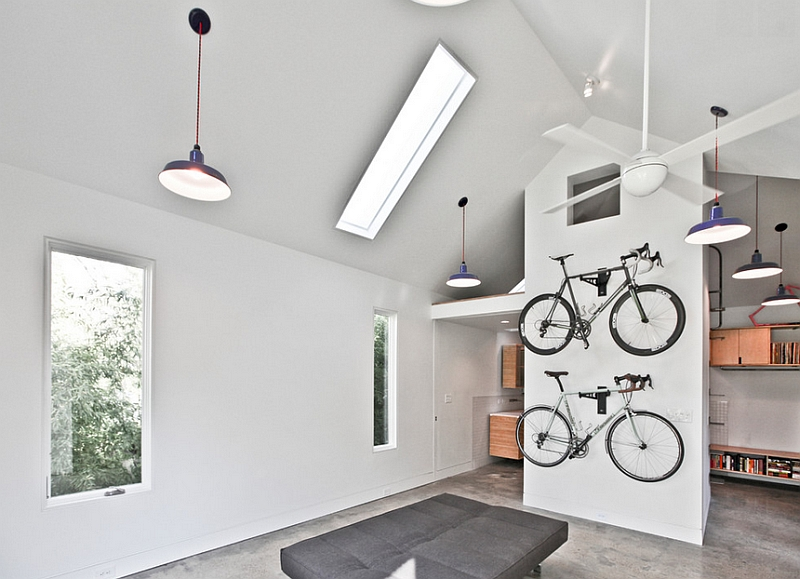 Contemporary bedroom with a minimal theme and a wall-mounted bike rack