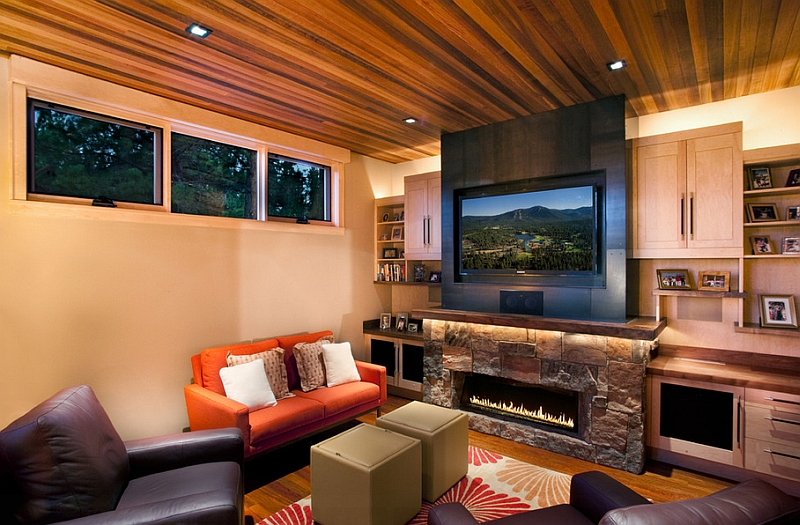 Contemporary family room makes best possible use of space with TV above the fireplace