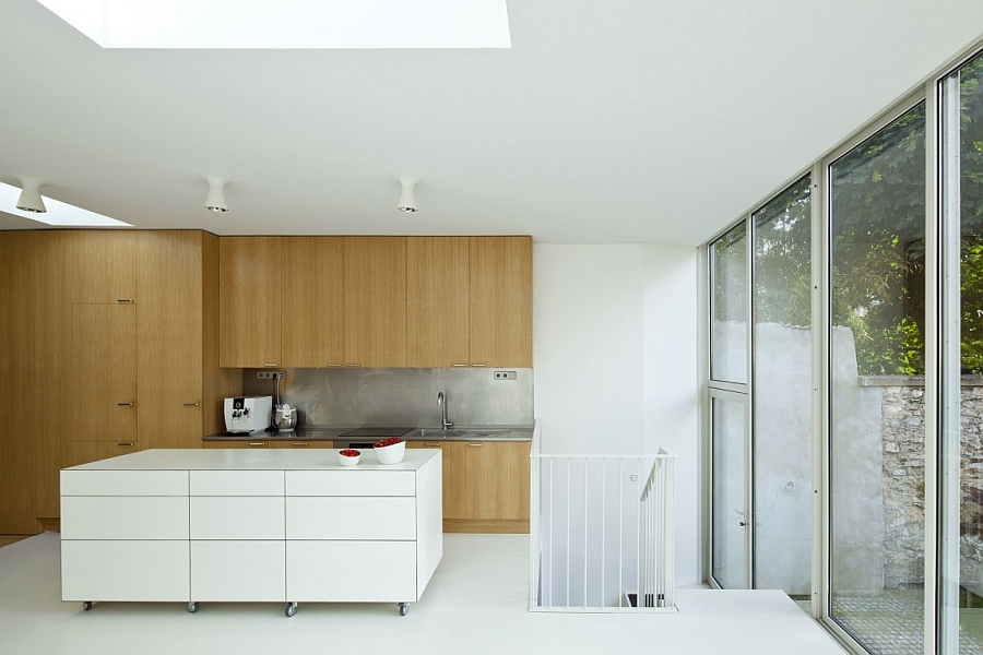 Contemporary kitchen with wooden cabinets and a white island on wheels