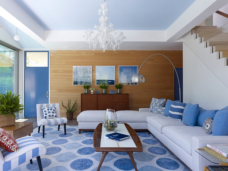 Contemporary living room in blue and white with a wooden accent wall