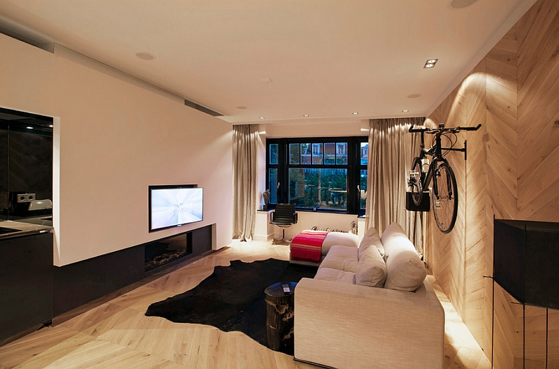 Contemporary living room with limited space and a wall-mounted bicycle