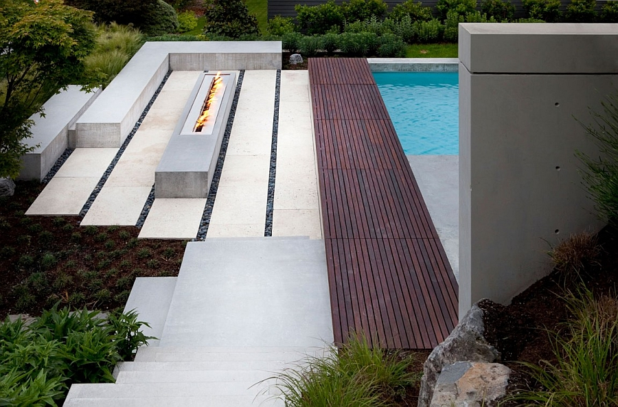 Contemporary outdoor fireplace next to the pool