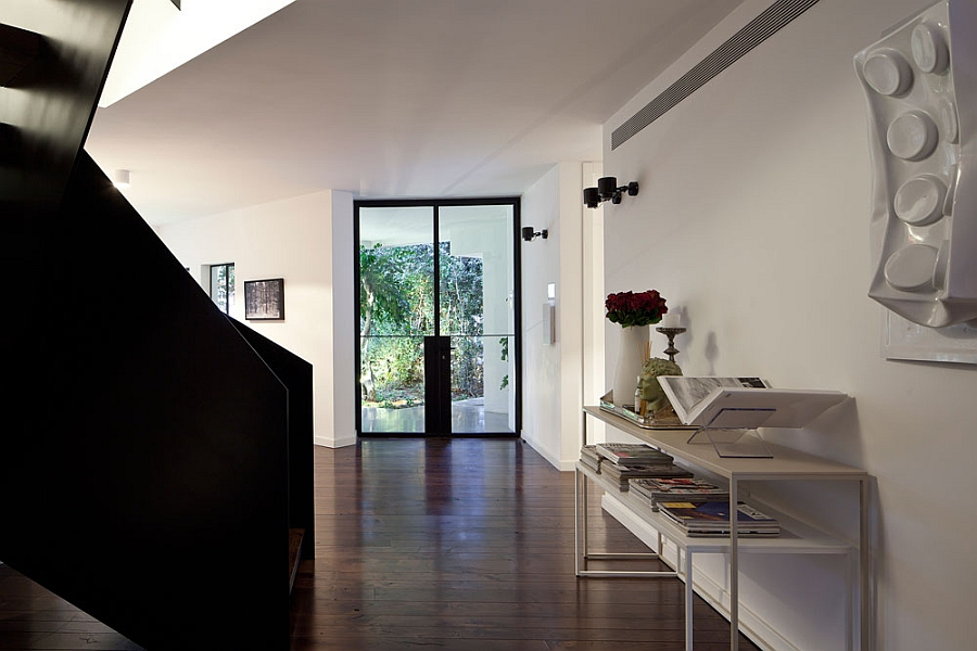 Contemporary staircase in black offers cool visual contrast