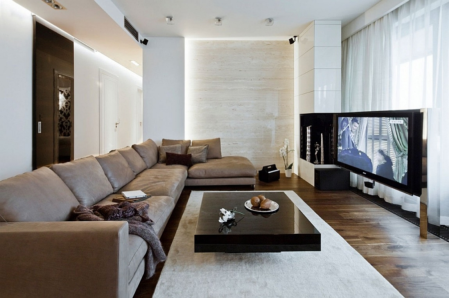 Cool living room with wall mounted entertainment unit Classy Warsaw Apartment Combines Beautiful Views With Elegant Design