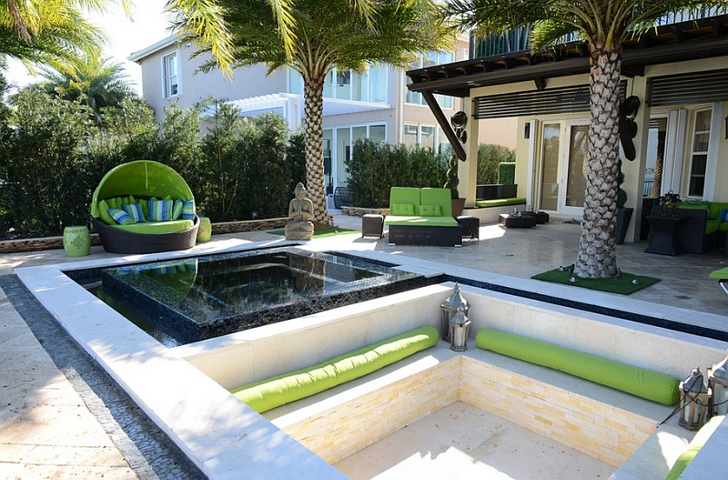 Cool sunken lounge in the patio with an exotic topical theme