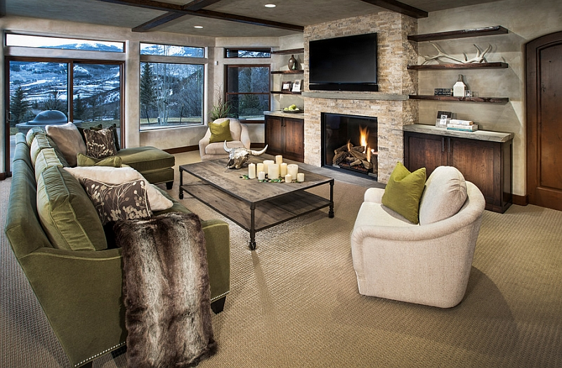 Cozy family room with floating shelves and a TV above the fireplace