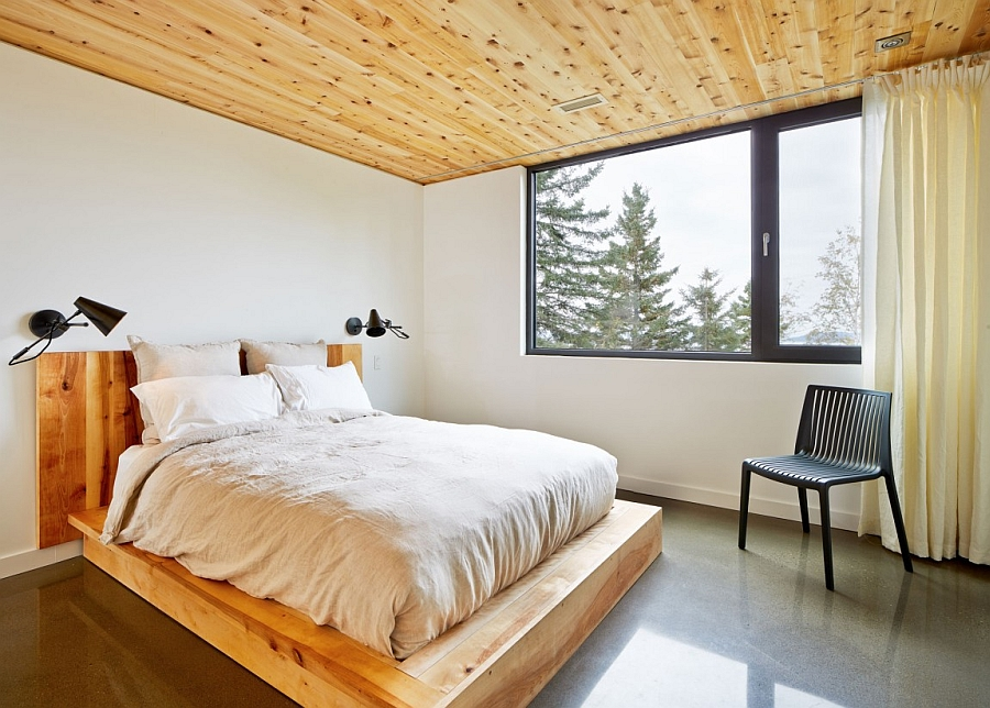 Cozy, minimal bedroom with a unique platform bed