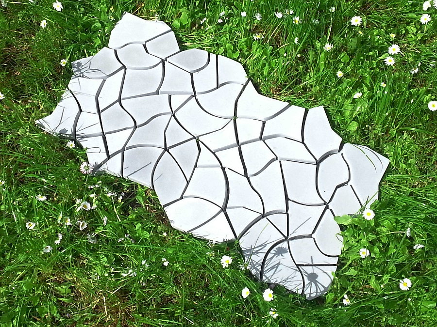 Cracked earth tile mimics the natural drying out of earth to perfection