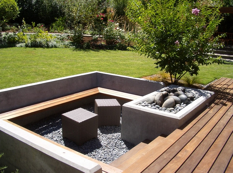 Cube ottomans add a touch of contemporary style to the sunken seating along with the firepit