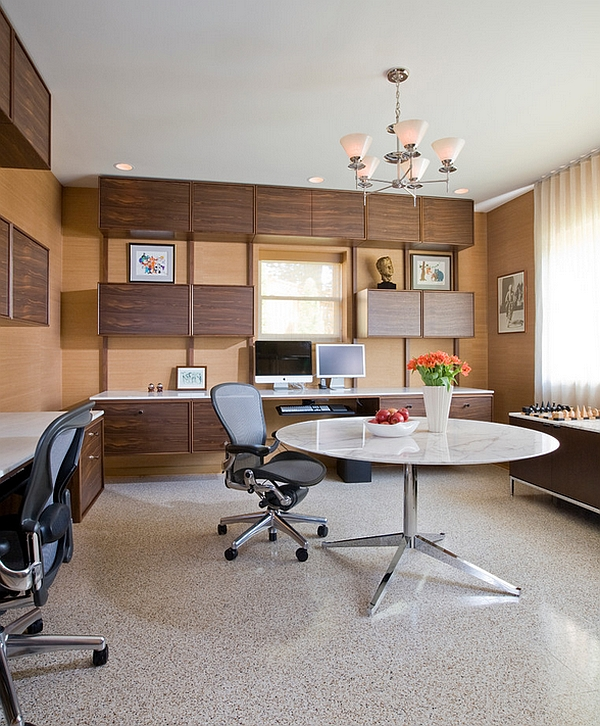 Custom floating cabinets and desks along with Midcentury modern decor for basement home office