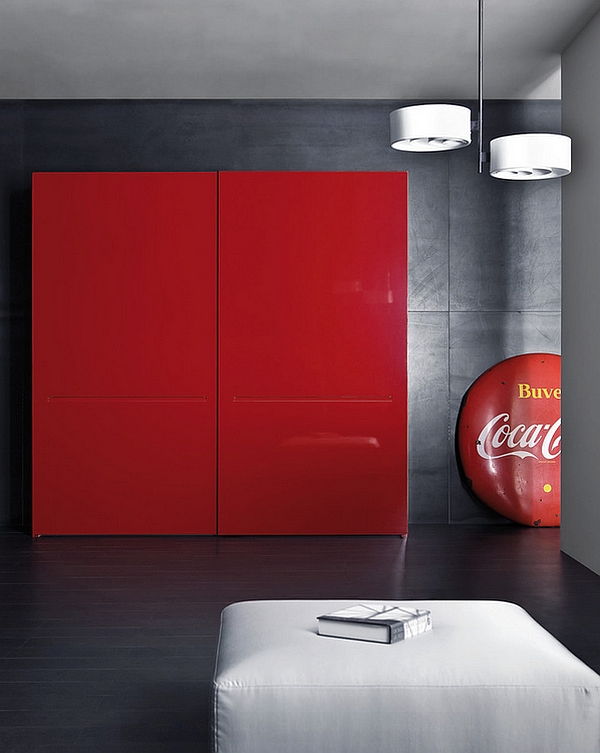 Custom made shelf in classic Coca-Cola red along with round coke logo in a minimal space