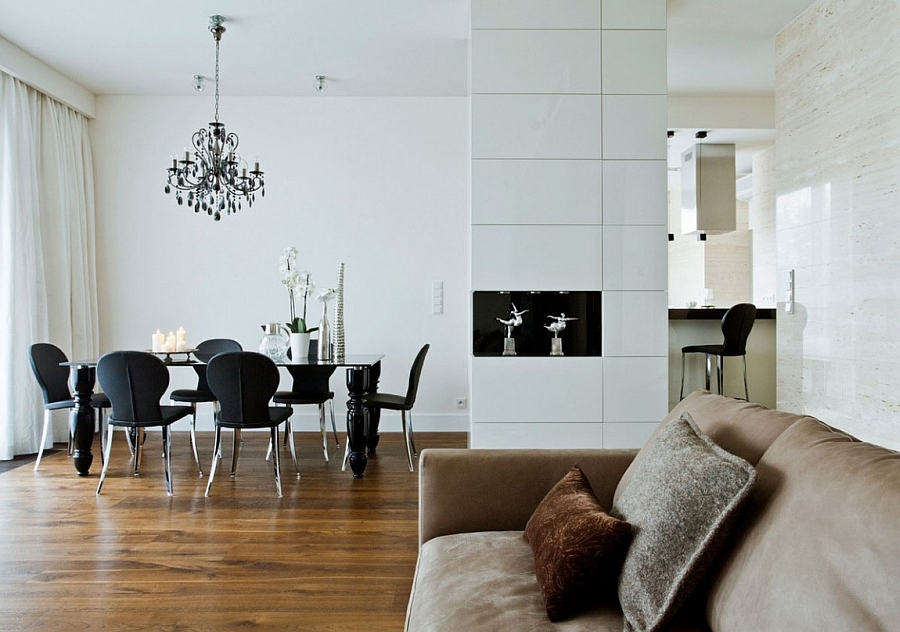 Dark dining room chairs standout thanks to the white backdrop