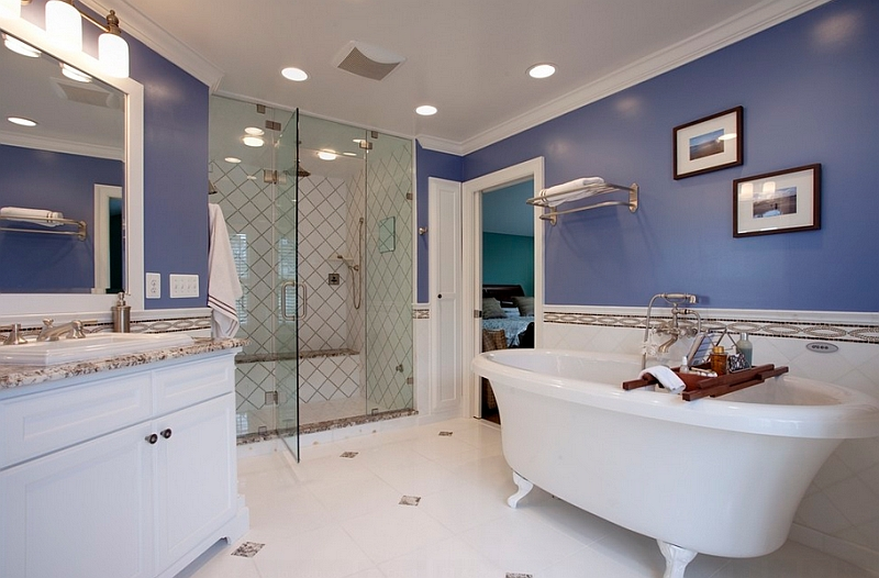 Darker shades of blue along with white give the bathroom a playful look