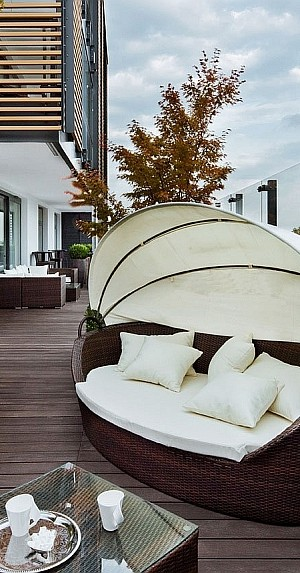 Daybed on the deck of Warsaw Apartment