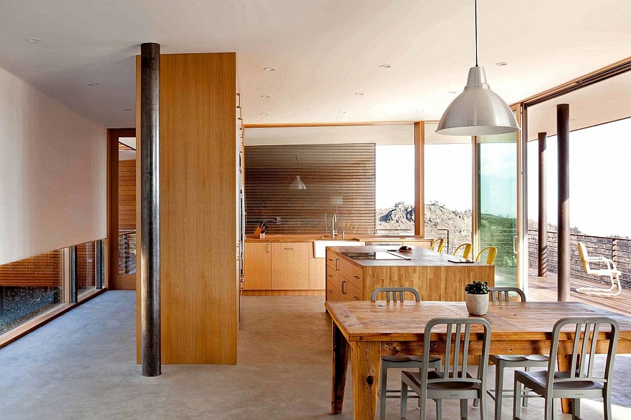Dining area and kitchen clad in wood