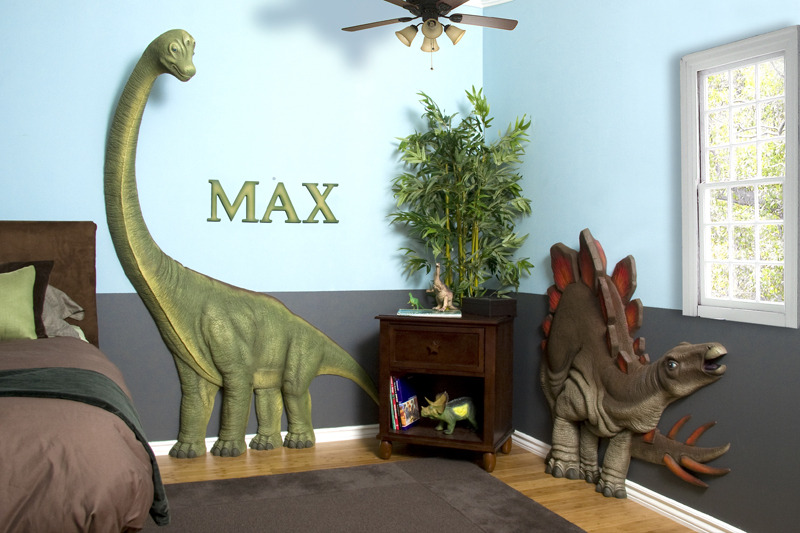Dinosaur themed boys bedroom with 3D wall additions