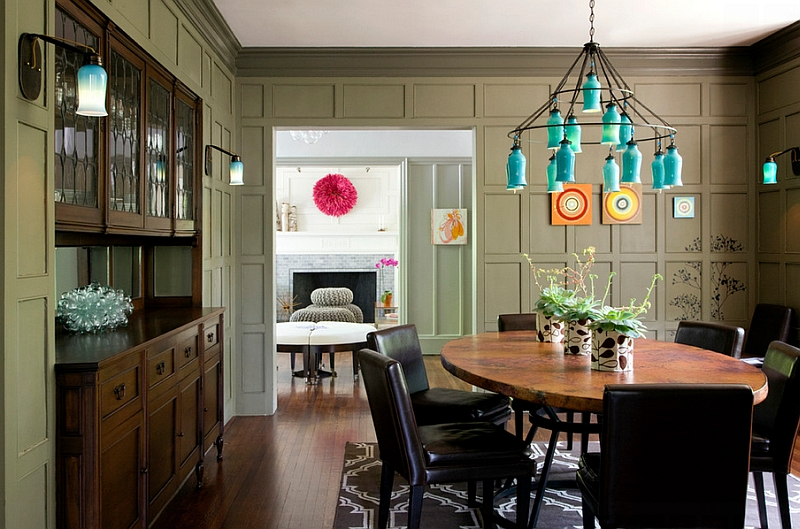 Eclectic dining room with sconces that complement the chandelier