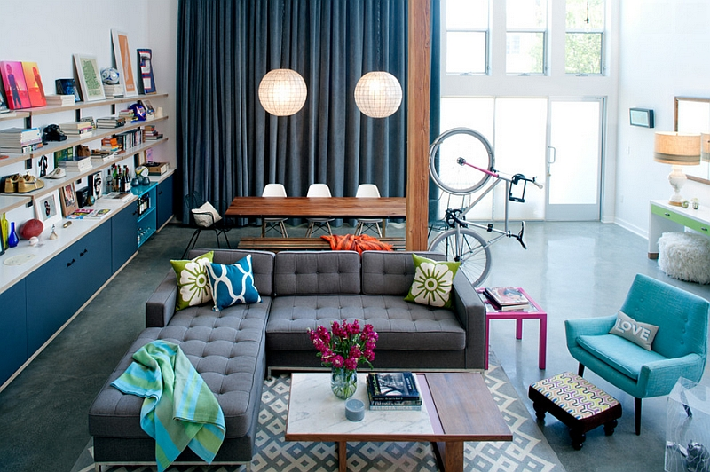 Eclectic living room with bright pops of color and a innovative bike display!