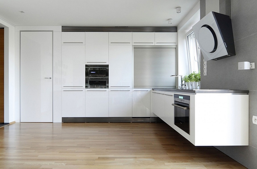 Ergonomic modern kitchen in white with floating shelves and counter