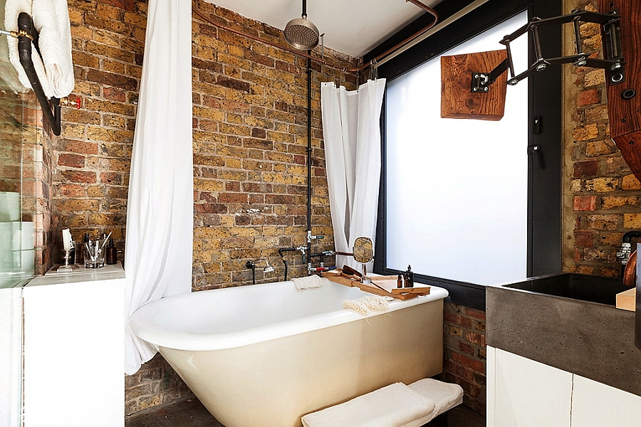 Exposed brick walls in the bathroom give it a rustic look