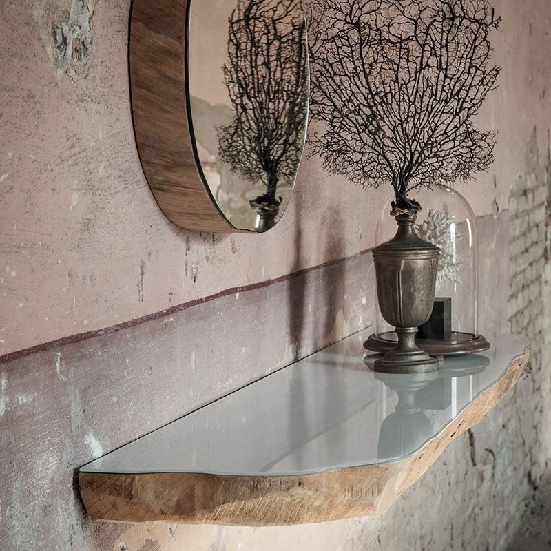 Floating tree trunk shelf with a mirrored finish