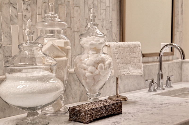 Glass apothecary jars help bring in a spal-like elegance to the bath
