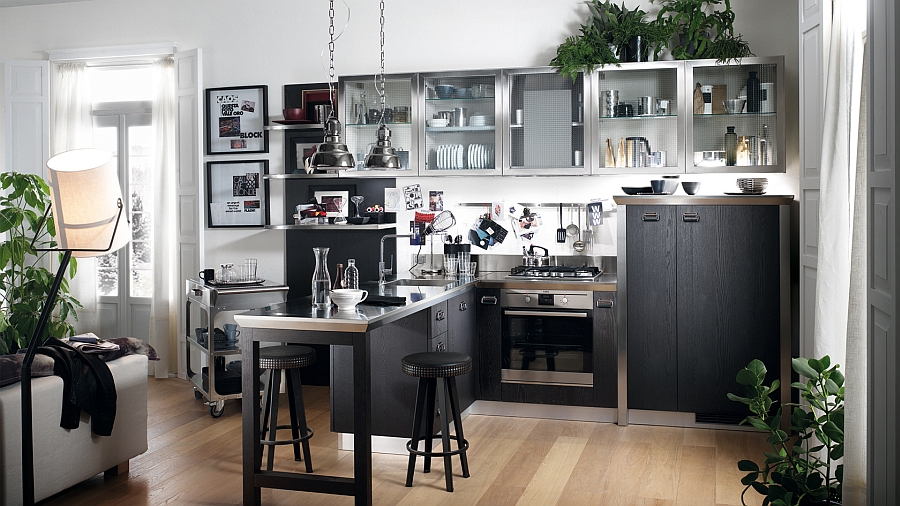 Glossy kitchen with stainless steel coutertop offers a cool social space