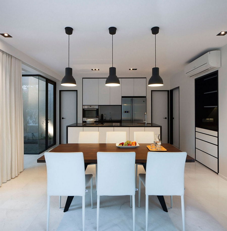 Goregous contemporary kitchen and dining area in the Singapore House