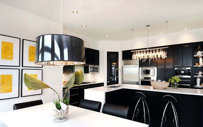 Gorgeous chandelier enlivens the black and white kitchen