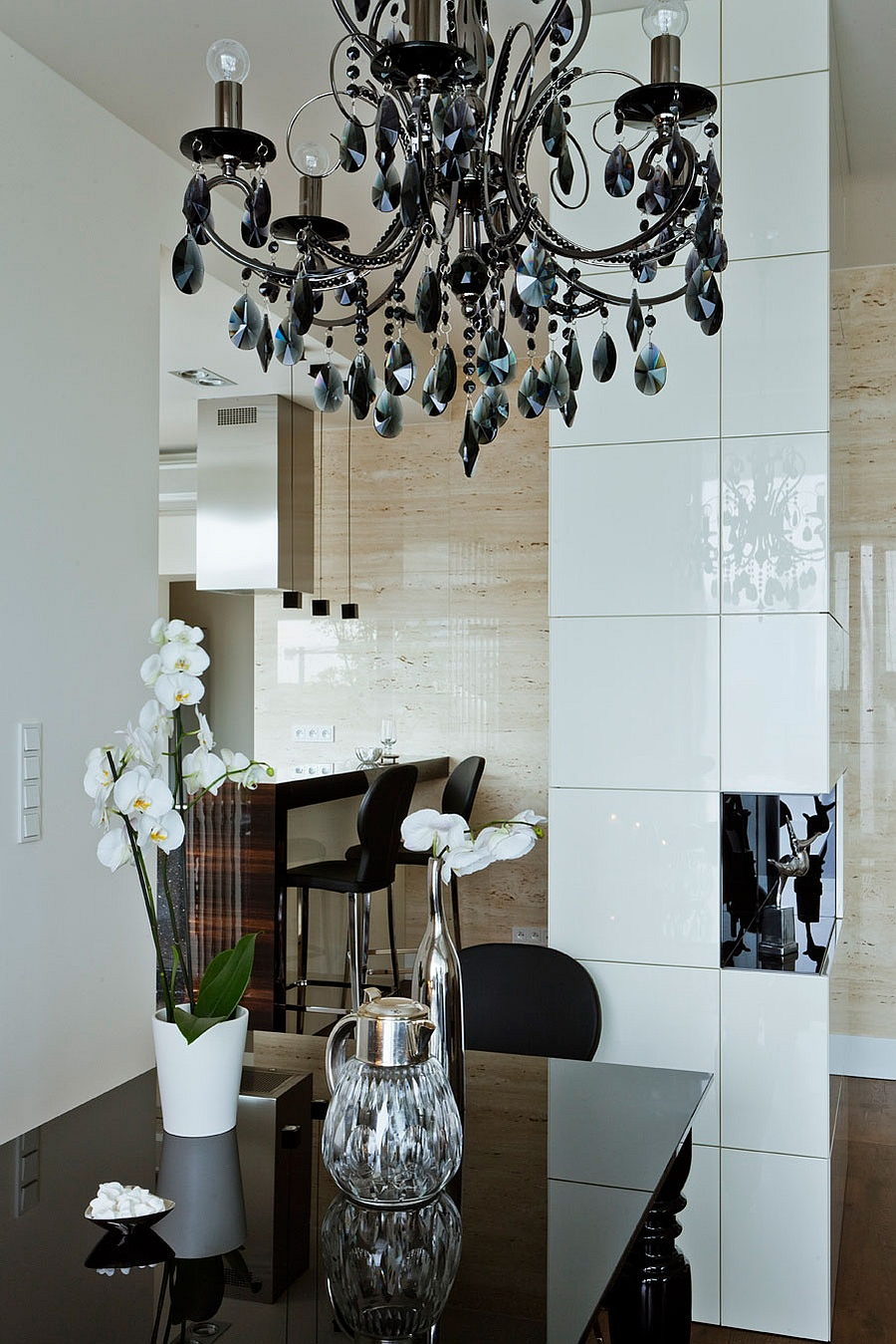 Gorgeous chandelier in black steals the show inside the sophisticated space