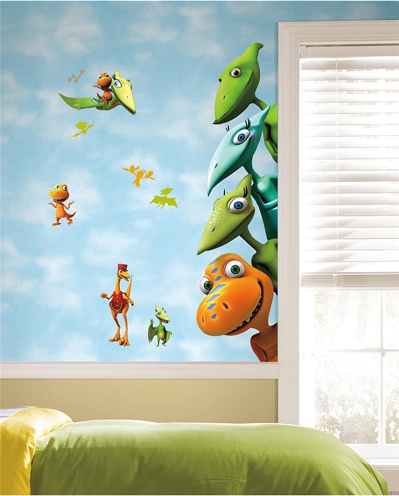 Gorgeous dinosaur themed kids' room with fun wall mural