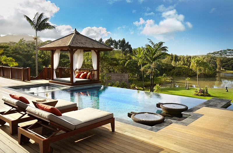Gorgeous gazebo with a outdoor bed next to the pool