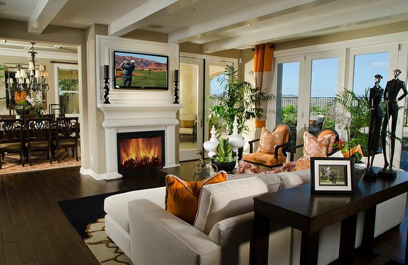 Gorgeous living room with TV above the classic fireplace