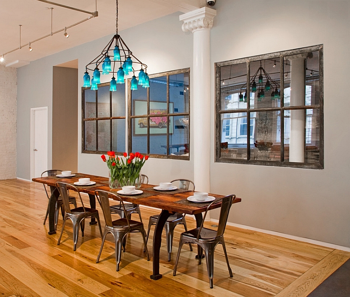 Industrial style dining room with a colorful chandelier