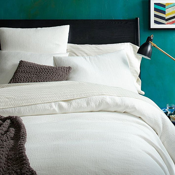 Inviting bedroom with teal walls