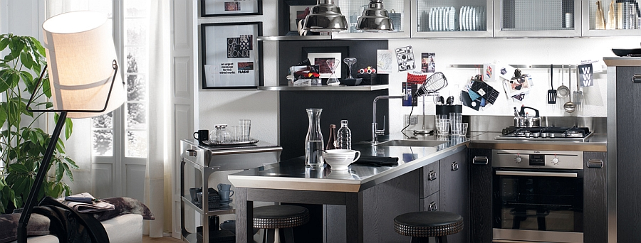 Kitchen with sparkling steel countertop, smart cart and glass door cabinets