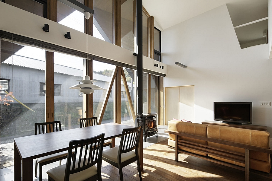 Large glass doors connect the interior with the deck outside