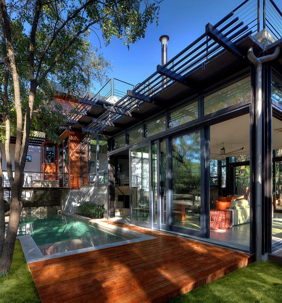 Large sliding glass doors connect the interior with the pool