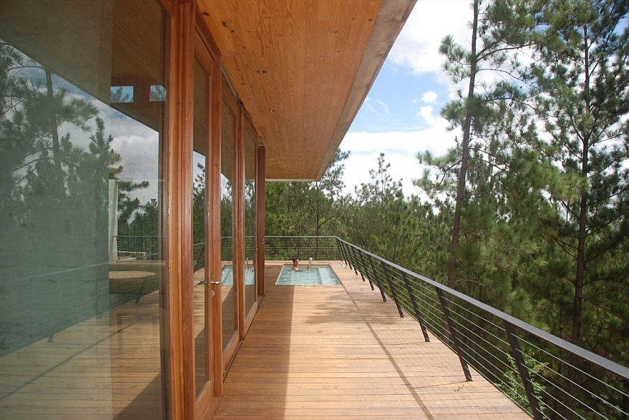 Large wooden deck with a pool at the end