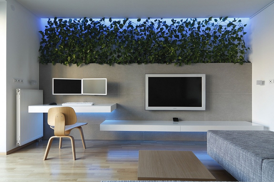 Living room with colorful LED lighting and a living wall