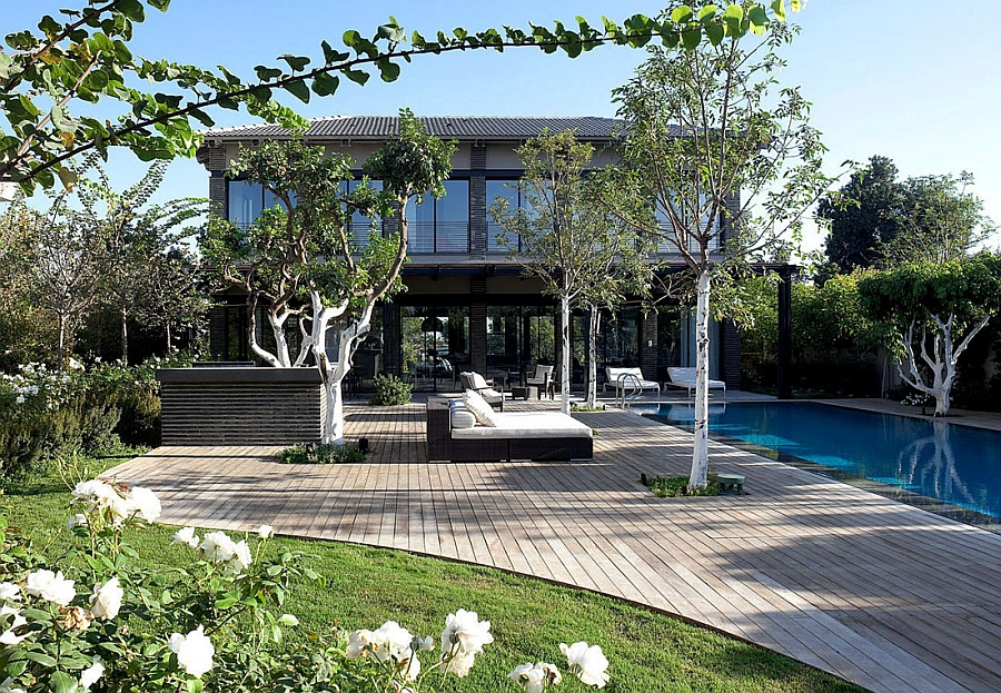 Lovely backyard with wooden deck and a lavish pool