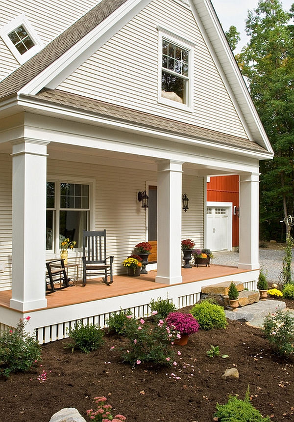 Lovely porch with colorful flowers and potted plants