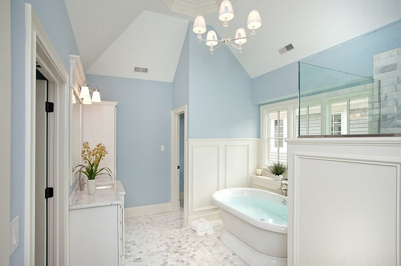 Luxurious traditional bath in blue and white by oakley home builders
