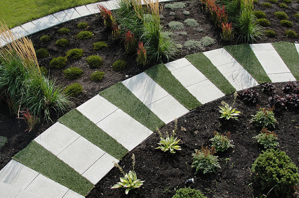 Manicured walkway and garden Finding The Right Color Scheme For Your Outdoor Space