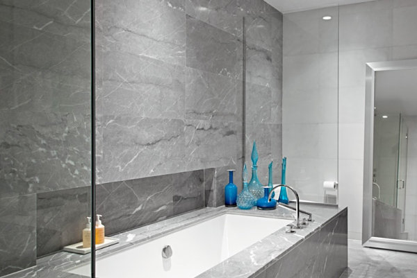 Master bathroom featuring grey marble