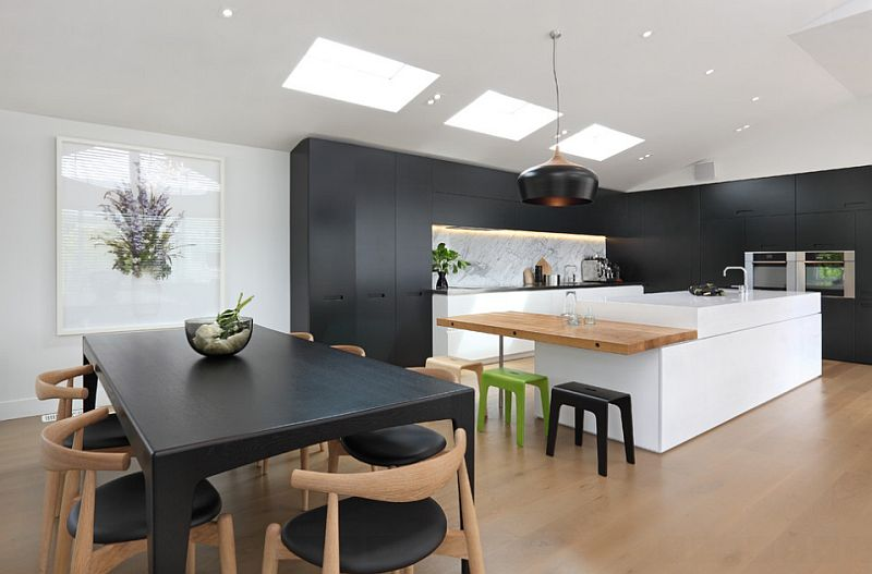 Matt black finishes and pristine white complement the warm, wooden floor