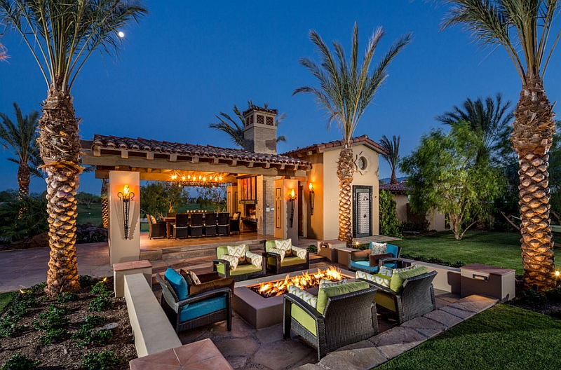 Mediterranean style patio with sunken seating and luxury pool