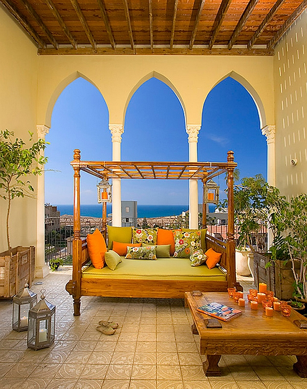Mediterranean style porch with a cozy outdoor bed